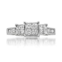 Celebrate the romance and eternal love you have built with this dynamic 1 cttw diamond engagement ring. Four sparkling Princess-cut center stones are beautifully surrounded by a 16 additional Princess
