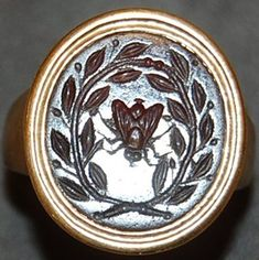 Cornelian intaglio: a fly wreathed with olive branches.