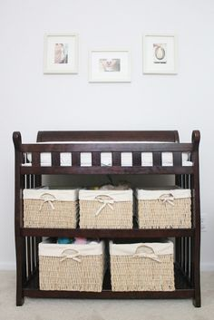 I have a white changing table I can donate and we could use colorful baskets underneath for storage similar to this.