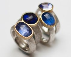 Selection of rings in sterling silver, 18 carat yellow gold, tanzanite, black opal, iolite.