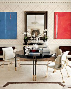 Having a custom sized mirror to create a triptych on the wall is clever..k.. by Richard Mishaan
