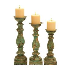 Your lanterns will be great outside on your deck, so if you want to use them for evenings on the deck, reconsider the candle sticks for the other side of the hearth. I like these. I am not sure they are big enough, but adding two more to make 5 would be incredible. Wooden Calming Green Finish Candle Holder (Set of 3)
