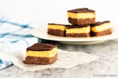 """""""These are the absolute best nanaimo bars, an amazing sweet treat that's a perfect addition to your holiday dessert table! A Canadian dessert, Nanaimo bars are a no bake treat that are absolutely fabulous. No Bake Treats, Yummy Treats, Delicious Desserts, Sweet Treats, No Bake Chocolate Desserts, No Bake Desserts, Dessert Recipes, Coconut Desserts, Vegan Desserts"""