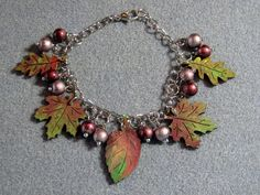 This handmade, one-of-a-kind autumn leaves jewelry design is one of several new fall designs I have created this season. Please see my other listings for other complementary jewelry pieces matching this theme. Currently, there are charm bracelets, necklaces and earrings available for sale; each features gorgeous autumn leaves in the colors of the season - different shades of red, orange, burgundy, brown, green and gold. These are extremely limited in quantity and no two pieces are exactly…