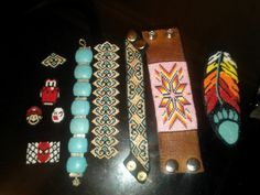 "Some more beadwork from ""Courtney's Collection"" by Courtney Cochran. :D  Random flat peyote stitch patterns then 4 bracelets and the feather was gonna be a medallion but I'm not sure yet."