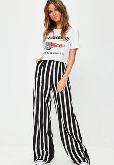 Black and white striped pants with a wide leg, two front pockets and relaxed fit.