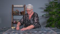 Learn how to baste a large quilt on a table that is smaller than the quilt.