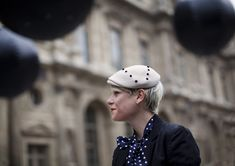 On the Street…Elisa at Louis Vuitton, Paris « The Sartorialist: beanie with polka dotted neck scarf!