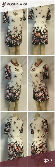 "40% BUNDLE DISCOUNT! FREE SHIPPING ON BUNDLES!! Floral Dress, size Small / Medium See Measurements, checked Medium box below, vertical fitted bodice dart seams, fully lined, sleeves gathered at shoulder, silky soft stretchy material, machine washable, polyester spandex blend, approximate measurements: 34"" length, 17"" bust laying flat, 11"" sleeves, 15"" back center zipper,  no tags. ADD TO A BUNDLE!?? 40% BUNDLE DISCOUNT! FREE SHIPPING ON BUNDLES!! ?OFFER? 40% less Plus $6 LESS ON BUNDLES for…"