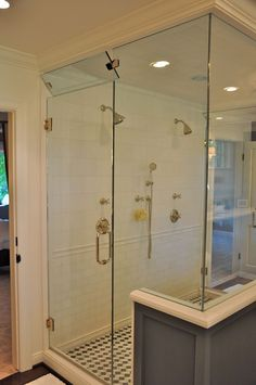 i like the large shower stall and how there is a door opening to bedroom on either side of it, allowing for better airflow.