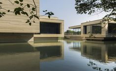 A collection of simple low-slung modernist cubes 'floating'above a lake in Wuzhen, China, is the latest cultural addition to the area's popular 'water-town' tourist resort, a maze of traditional canals with stone lanes and classic shop-houses about a...