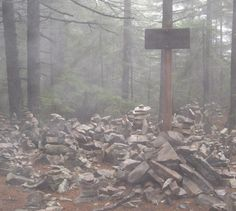 Misty cairns left by hikers,  White Rocks Mountain