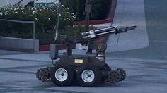 Police robot seizes rifle from suspect