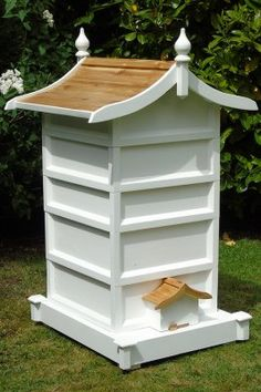 The Lichfield Bee hive with its curved varnished cedar roof and thick framed walls is a handsome home for your honey bees.