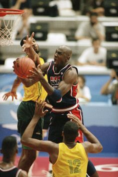 USA's Michael Jordan takes the ball to the hoop past the out stretched arms of Brazil's Josuel Aristides Santos for two points during first half action of their game at the XXV Summer Olympic Games in Barcelona, Friday, July 31, 1992. USA won the game 127-83.