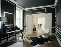 I absolutely love black walls and white molding. Need someone to let me do this in their house!