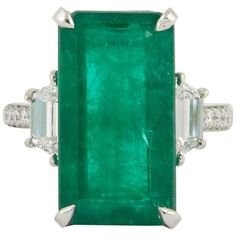 Unique Elongated 10 Carat Green Emerald Ring | From a unique collection of vintage fashion rings at https://www.1stdibs.com/jewelry/rings/fashion-rings/