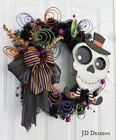 I really like this wreath...although I'm not a big fan of the skeleton head with feet...I'd probably use a cute little ghost or witch instead :)