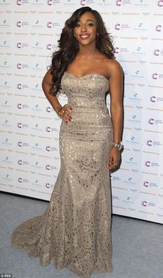 Lace dress: X Factor winner Alexandra Burke, who wore a strapless lace dress - which was f...