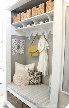 Converted closets can turn an entryway into a mini mudroom. A sitting area within a long closet is perfect for taking off shoes when entering a home. The baskets on the high shelf are great for storing small umbrellas, gloves, and any outdoor wear.