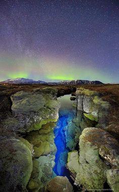 Pingvellir Iceland aurora borealis over Silfra crack