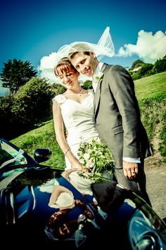Wedding couple with wedding car.Exeter Wedding by Grant Stringer