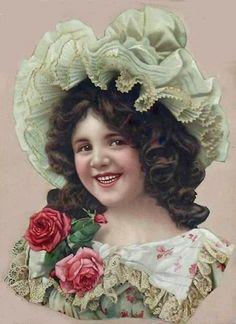 Victorian die-cut scrap of little girl in frilly lace bonnet