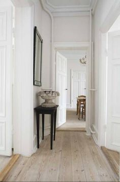 limed wood floor and white - hall