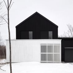 Toronto firm Atelier Kastelic Buffey has completed a black-and-white ski chalet in Ontario echoing the area's traditional barns and farmhouses.