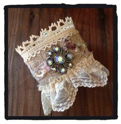 Fabric cuff made with vintage lace and rhinestones By LjBlock Designs