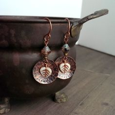 Hand forged copper earrings with cream colored leaves.  When you want that rustic, woodland look!  Perfect for fall season! By southwinddesign.etsy.com