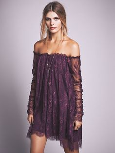 Angel Lace Trapeze Mini Dress | Femme lace babydoll. Dramatic lace panels cascade from sheer ruched sleeves to complete the look. Bodice lined.