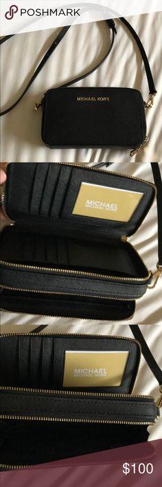 Michael Kors Black wallet crossbody Good condition. Used handful of times Michael Kors Bags Crossbody Bags
