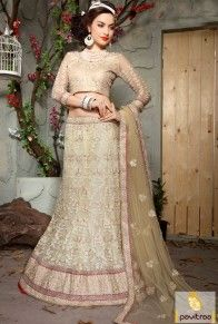 Buy net brocade fashionable lehenga choli online in beige color for marriage anniversary and wedding reception. Pavitraa.in offer stylish ghagra cholis in low prices. #lehengacholi, #designercholi more: http://www.pavitraa.in/store/designer-collection/