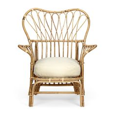 Arm Chair 311 | Josef Frank designed many pieces of furniture in rattan and bamboo for Svenskt Tenn | Easy Chair 311, designed in the 1930s, has as is so often the case with Frank's designs, an airy feeling with its slender-limbed pattern and gently rounded back and arms