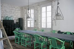 sea green chairs + lamp pendants
