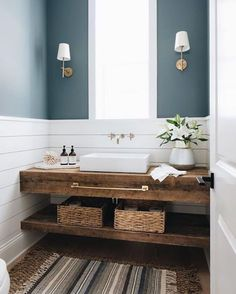 Farmhouse Bathroom features shiplap wainscoting an. Farmhouse Bathroom features shiplap wainscoting and a custom floating vanity made out of reclaimed wood Bathroom features shiplap wainscoting and a custom floating vanity made out of reclaimed wood Reclaimed Wood Vanity, Wood Sink, Reclaimed Wood Shelves, Coastal Farmhouse, Farmhouse Homes, Farmhouse Vanity, Farmhouse Interior, Bathroom Trends, Bathroom Interior