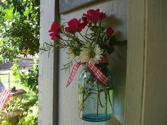 Mason jar holds my blooms.Tie wire or string at the top of jar to hang. Mason Jar Vases, Blue Mason Jars, Bottles And Jars, Mason Jar Crafts, Glass Jars, Fresco, Porch Decorating, Decorating Ideas, Craft Ideas
