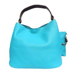 Day To Day Shoulder Bag – Turquoise. This day-to-day carryall features centre strap with gold hardware as decorative materials. Features an insert bag with a gold chain strap. Vegan friendly and soft to the touch, this bag is a girl's best friend this season. Open Top, Magnetic Closure. High quality leather like texture.