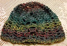 Helmet or Cap with Skulls - Free crochet pattern by Alice Bakker-Sicking. With links for matching gauntlets and shawl.