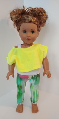 Excited to share the latest addition to my #etsy shop: American girl Doll clothing. 18 inch doll clothes. White Tank top , neon yellow shoulder top and workout leggings #toys #dollclothes #shirts #yellow #white #18inch #activewear #tanktop #leggings https://etsy.me/2Gq1U79