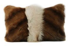 Pillows made from vintage fur coats.  Lush and plush.