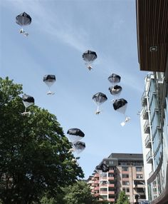 A handout photo provided by Swedish firm Studio Total shows teddy bears falling to the ground over a residential area in Minsk, Belarus, on July 4, 2012 in the name of Pro-Democracy. Once described as Europe's last dictator, President Lukashenko is known as an authoritarian leader opposed to freedom.
