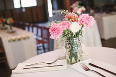 Clear mason jar with White Carnation Centerpieces