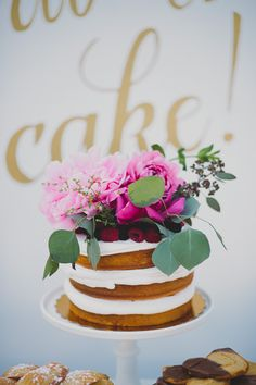 Naked cake with floral topper | Photo by Katie Pritchard Photo | Read more - http://www.100layercake.com/blog/?p=76900
