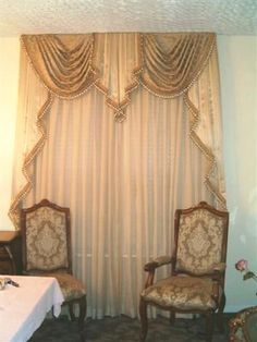 The Color Of This Jabot Matches That Of The Chairs Underneath Really Well.  Between The