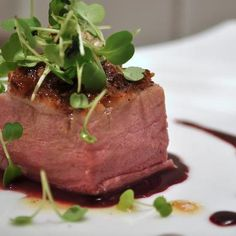 Coriander-scented roasted duck breast with crispy skin wading in a dreamy pool of huckleberry gastrique and topped with arugula microgreens. Enjoy the rest of the Cristom 2008 PInot Noir, Willamette Valley. https://www.facebook.com/photo.php?fbid=10151137921841238