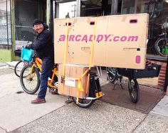 Simon's about to take off on the Xtracycle Edgerunner 27D with Bionx electric assist to take this boxed bike and some extra stuff to Fedex.