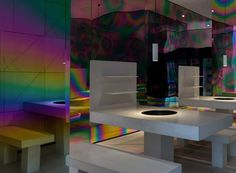iridescent diner by infinity nide features colored electroplated steel and white concrete | Netfloor USA
