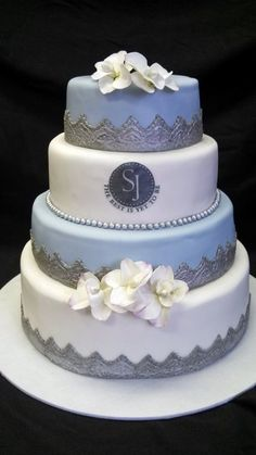 """""""The Best is Yet to Be""""  ~ Silver ornate bases ( all edible), baby blue and pearly Wedding Cake"""